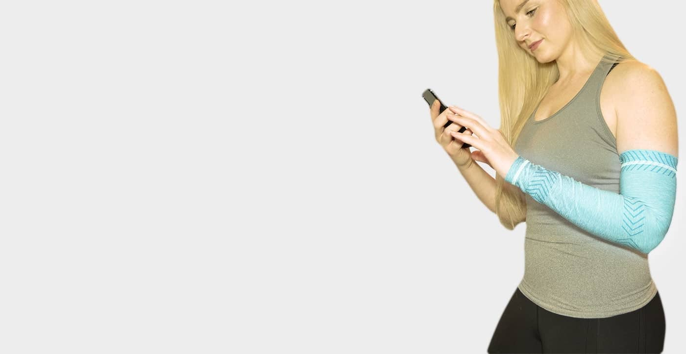 Woman using the AIO Sleeve app on her iPhone